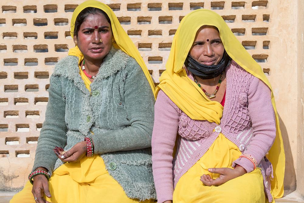 Two indian women sitting