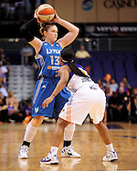Sep 25, 2011; Phoenix, AZ, USA; Minnesota Lynx guard Lindsay Whalen  (13) reacts on the court against Phoenix Mercury guard Temeka Johnson (2) at the US Airways Center. The Lynx defeated the Mercury 103-86. Mandatory Credit: Jennifer Stewart-US PRESSWIRE