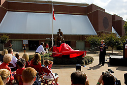 19 September 2009: Will Robinson Jr. And Doug Collins pull on ropes to unveil a statue created from a photograph by Lou Cella. Illinois State University took the day to celebrate 2 of it's own, the late Will Robinson and national hero Doug Collins.  Will Robinson became the first black head basketball coach in NCAA Division I history when names ISU basketball coach in 1970.  Doug Collins was an Illinois State standout basketball player who represented the United States in the 1972 Olympics, played NBA ball for several years where he later coached and recently recieved the Curt Gowdy Media Award for career in broadcasting.  A statue was erected in their honor on the terrace just north of the main entrance to Redbird Arena on ISU's campus in Normal IL