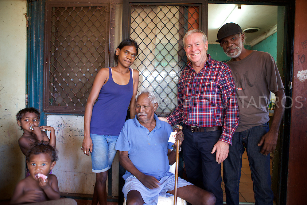 "Sardie and Mia, posing with Chrissy Wiggan, Kennedy Hill's 88-year-old Elder Roy Hunter Wiggan, Colin Barnett, Premier of Western Australia and Rodney Wiggan, (L-R) during a brief visit in Kennedy Hill, a small Aboriginal Community, in the town centre of Broome, WA. ""The main reason is that the children are safe, we won't bulldoze all Aboriginal Communities, but they can't all stay, mentioned the Premier. Broome, Western Australia ©ingetje Tadros/Diimex"