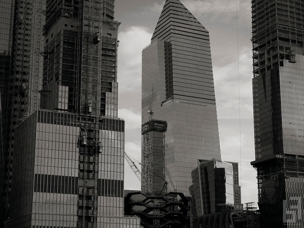 One Manhattan West reflected in the glass of 10 Hudson Yards. The largest redevelopment project under construction in 50 years nears the halfway mark on Manhattan's west side.  Architectural firm and principal Kohn Pedersen Fox was lead site design for Related Companies real estate and commericial project