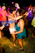 Two women dancing with each other. Friday 14th of Nov 2008- The first dance festival in the Middle East. Coma festival, Al Maya Island, Abu Dhabi, UAE. Middle East