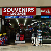 UK PM Boris Johnson announces closure of pub, bars and restaurants to fight Coronavirus - Pandemic hit Oxford Street many shops closure a few open but empty on 21 March 2020, UK.