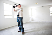 SACRAMENTO, CA - DECEMBER 2:   NorthWoods inspector Manny Nevarez inspects a foreclosed home for needed repairs in Sacramento, California December 2, 2008. Many foreclosed homes need substantial repairs before going on the market. (Photo by Max Whittaker/Getty Images)