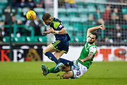 Adam Jackson (#18) of Hibernian FC slide tackles Andrew Dales (#26) of Hamilton Academical FC during the Ladbrokes Scottish Premiership match between Hibernian FC and Hamilton Academical FC at Easter Road Stadium, Edinburgh, Scotland on 22 January 2020.