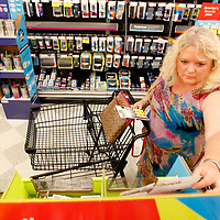 Connie Gusmus, a seventh grade science teacher at Guntown Middle School, shops for highlighters and other basic school suplies for her classroom at OfficeMax in Tupelo.