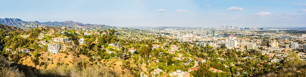 Panorama of homes in the hills of Los Angeles (and in the background left to right: the Hollywood Sign, Griffith Observatory & Downtown LA), California, USA