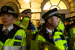 A right wing activist takes a selfie from behind a group of police officers who have just arrested him outside Parliament in London where MPs are debating Prime Minister Theresa May's Brexit deal whilst outside both Leave and Remain groups demonstrate. London, January 15 2019.