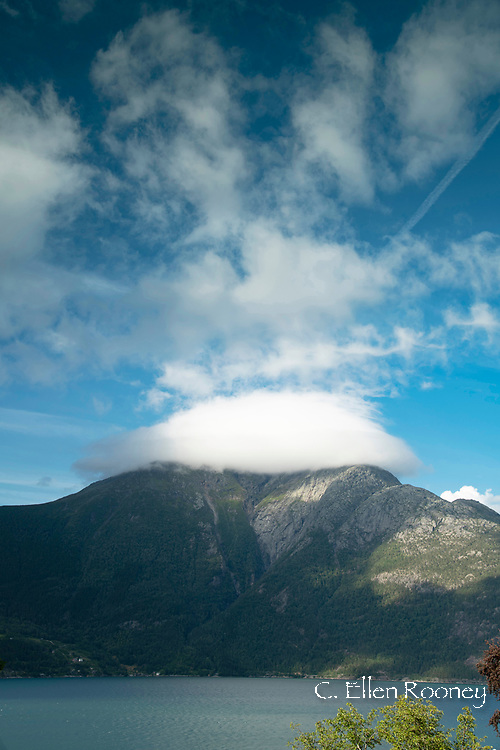 An unusual cloud formation hanging over a mountain on Hardanger Fjord, Vestlandet, Norway, Europe
