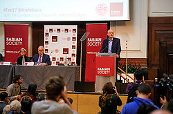 © Licensed to London News Pictures. 14/01/2017. London, UK. Labour Party leader JEREMY CORBYN (right) speaking at the Fabian Society conference in London on January 14, 2016. Corbyn has come under further pressure as leader following the resignation of Stoke-on-Trent, Tristram Hunt. Photo credit: Ben Cawthra/LNP