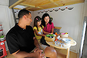 Three-year-old Emma Morales serves her parents, Geo and Gwen, lunch in the kitchen area on the first floor of the Snow White House. The second level of the village centerpiece has an reading loft and a slide. As seen on HGTV's My House Goes Disney.