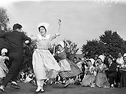 15/05/1959<br /> 05/15/1959<br /> 15 May 1959<br /> International Folk dancers at Wills tobacco factory. About sixty folk dancers from France, Denmark, India, Netherlands, Switzerland and Ireland, who were performing at the National Stadium, toured the W.D. & H.O. Wills factory at South Circular Road, Dublin. Afterwards they gave a performance in the factory garden. Picture shows the French dancers from Bordeaux performing the Peiroutoun dance, watched by the other dancers and Wills staff.