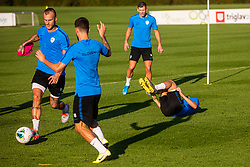 Aljaz Struna with Miha Zajc lying on the ground during practice session of Slovenian national football team in national football center in Brdo, 2nd of September, 2019, NNC Brdo. Photo by Grega Valancic / Sportida