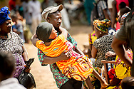 A man carries a woman to the clinic on the first day of the LCMS Mercy Medical Team on Monday, May 7, 2018, in the Yardu village outside Koidu, Sierra Leone, West Africa. LCMS Communications/Erik M. Lunsford