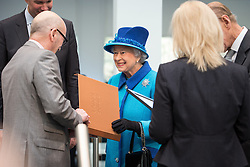© Licensed to London News Pictures . 14/11/2013 . Manchester , UK . The Queen is presented with a gift of photographs of the construction of the building . Queen Elizabeth II and the Duke of Edinburgh visit the Coop building at 1 Angel Square , Manchester , this morning ( 14th November 2013 ) . Photo credit : Joel Goodman/LNP
