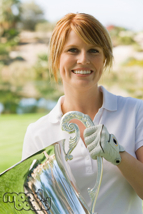 Golfer Holding Tournament Trophy