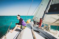 Jacki Arevalo sailing on the Grand Illusion II, a Navtours charter ship, Exumas, Bahamas.
