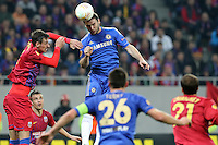 Chelsea's Branislav Ivanovic (C) vies with Steaua Bucharest's Lukasz Szukala (L) during the first leg of the UEFA Europa League round of 16 football match between Steaua Bucharest and Chelsea at the National Arena Stadium in Bucharest on March 7, 2013.