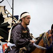 "MINAMISOMA, JAPAN - JULY 24 : A samurai horseman is seen as he compete in the Shinki-soudatsusen (sacred flag competition) during the Soma Nomaoi festival at Hibarigahara field on Sunday, July 24, 2016 in Minamisoma, Japan. ""Soma-Nomaoi"" is a traditional festival that recreates a samurai battle scene from more than 1,000 years ago.  (Photo: Richard Atrero de Guzman/NURPhoto)"