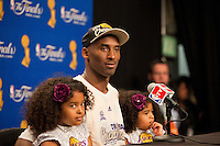 17 June 2010: Guard Kobe Bryant of the Los Angeles Lakers speaks to the media with his daughters Gianna and Natalia after the Lakers defeat the Boston Celtics 83-79 and win the NBA championship in Game 7 of the NBA Finals at the STAPLES Center in Los Angeles, CA.