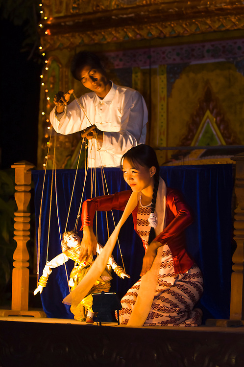 Woman acting as human puppet as puppeteer controls a marionette, Mandalay, Myanmar (Burma)