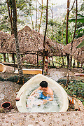Vietnamese man soaking in a hot tub at My Lam Hot Springs