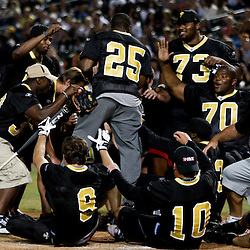 May 17, 2011; Metairie, LA, USA; New Orleans Saints running back Reggie Bush (25) celebrates with teammates after hitting a homerun during the Heath Evans Foundation charity softball showdown featuring the offense versus the defensive players at Zephyrs Field.  Mandatory Credit: Derick E. Hingle