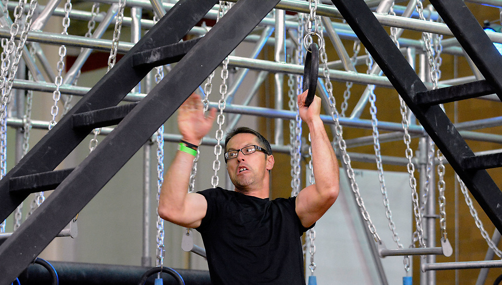 """jt051017e/sports/jim thompson/ Sam Rivera works his way along the """"Devil's Steps""""to finish  the Alpha Warrior Obstacle Competition on Kirkland Air Force Base. May. 10, 2017. (Jim Thompson/Albuquerque Journal)"""