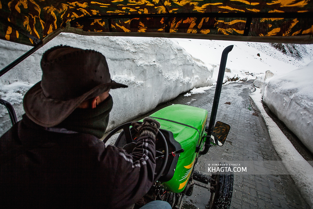 Amit Chaudhary driving the tractor on the Srinagar Leh Highway at Zoji La Pass, Kashmir...In May 2012, Fox Adventure Club set a record for the Longest Tractor Expedition, when three members covered 3623 kms across the western Himalayas in just 14 days on a 65hp Farm Tractor.