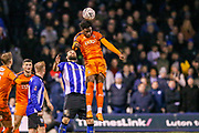 Luton Town midfielder Pelly-Ruddock Mpanzu (17) heads the ball during the The FA Cup 3rd round replay match between Luton Town and Sheffield Wednesday at Kenilworth Road, Luton, England on 15 January 2019.