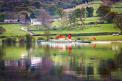 © Licensed to London News Pictures. 30/04/2019. Pooley Bridge UK. The 1877 steamer M.Y Lady of the Lake cruises across the calm water of Ullswater lake this morning on route to Pooley Bridge in Cumbria. The Lady of the Lake is believed to be the oldest working passenger vessel in the world. Photo credit: Andrew McCaren/LNP