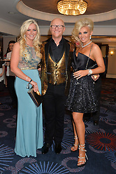 Left to right, MICHELLE MONE, JOHN & CLAIRE CAUDWELL at the Caudwell Children's annual Butterfly Ball held at The Grosvenor House Hotel, Park Lane, London on 15th May 2014.