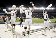 Northwest Missouri's Cass Weitl (73) Collin Bevins (11) and Jack Young (5) celebrate winning the NCAA Division II National Championship football game against Shepherd, Saturday, Dec. 19, 2015, in Kansas City, Kan. Missouri defeated Shepherd  34-7. (AP Photo/Colin E. Braley)