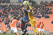 Bradford City striker Kai Brunker (21) and Blackpool goalkeeper Joe Lumley (28) during the EFL Sky Bet League 1 match between Blackpool and Bradford City at Bloomfield Road, Blackpool, England on 7 April 2018. Picture by Craig Galloway.