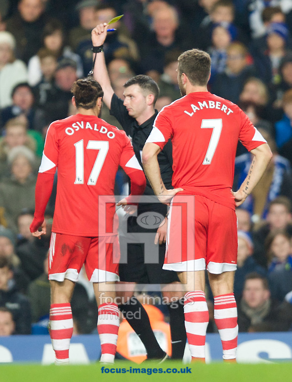 Picture by Alan Stanford/Focus Images Ltd +44 7915 056117<br /> 01/12/2013<br />  Daniel Osvaldo of Southampton is shown the yellow card by referee Michael Oliver during the Barclays Premier League match at Stamford Bridge, London.