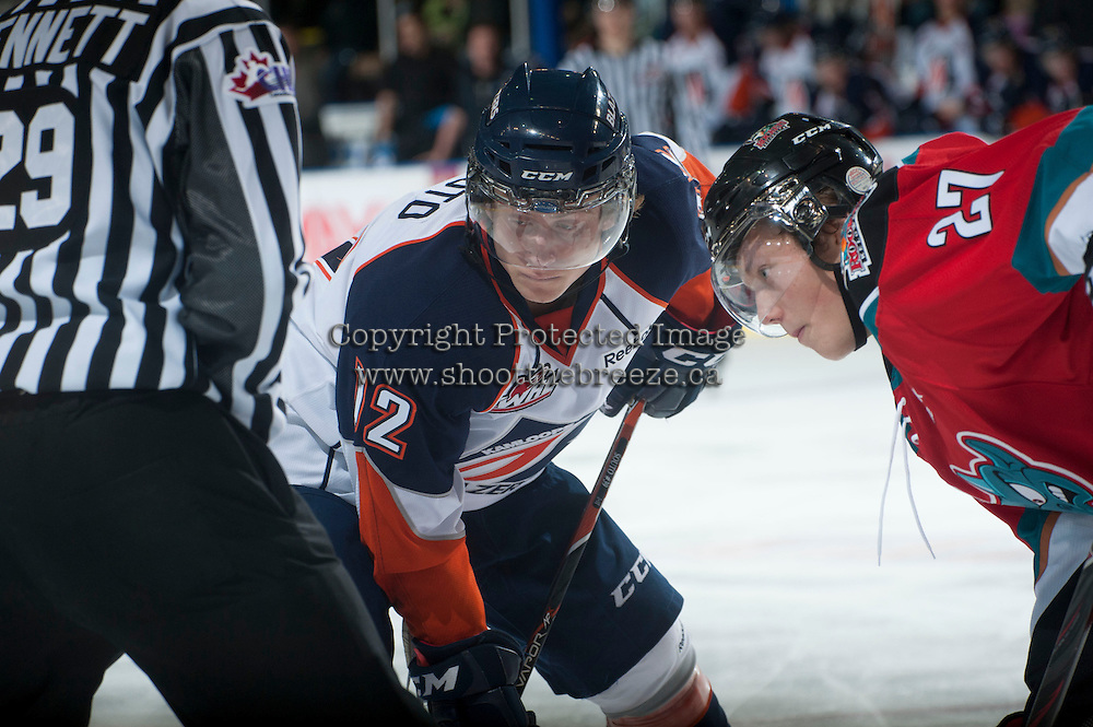 KELOWNA, CANADA - NOVEMBER 1:  Chase Souto #12 of the  Kamloops Blazers faces off against Ryan Olsen #27 of the Kelowna Rockets at the Kelowna Rockets on November 1, 2012 at Prospera Place in Kelowna, British Columbia, Canada (Photo by Marissa Baecker/Shoot the Breeze) *** Local Caption ***