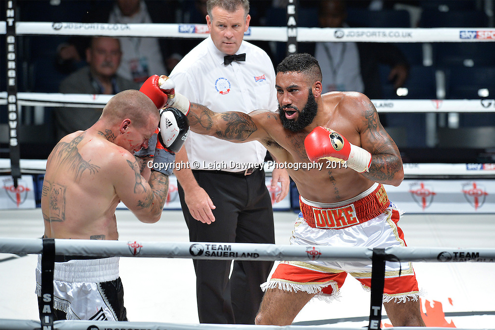 Luke Watkins (white/red shorts - debut fight) defeats David Vicena in a Cruiserweight contest at the SSE Wembley Arena, London on the 20th September 2014. Sauerland Promotions. Credit: Leigh Dawney Photography.