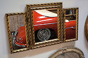 Image of a Porsche Speedster reflected in framed mirrors, Seattle, Washington, Pacific Northwest