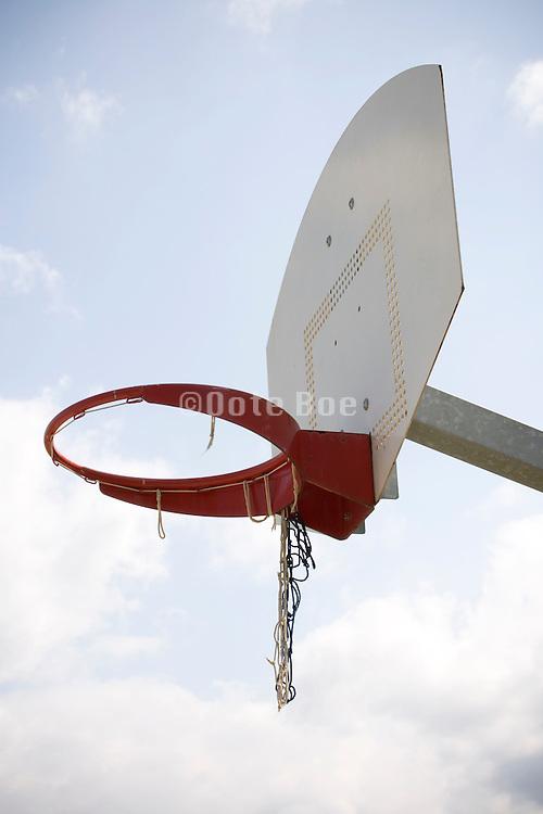 basketball hoop with broken net