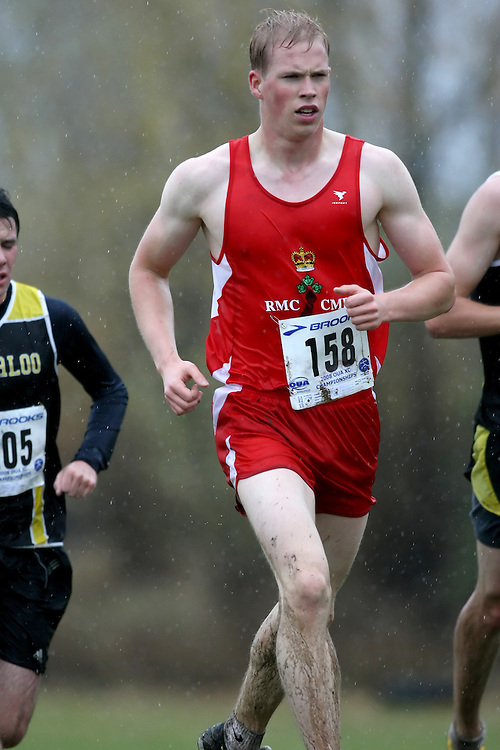 (Kingston, ON---25 October 2008) Jacob Trivers of ROYAL MILITARY COLL. University running to finish 78 in the 2008 Ontario University Athletics men's cross country championship.  Photograph copyright Sean Burges/Mundo Sport Images (www.msievents.com).