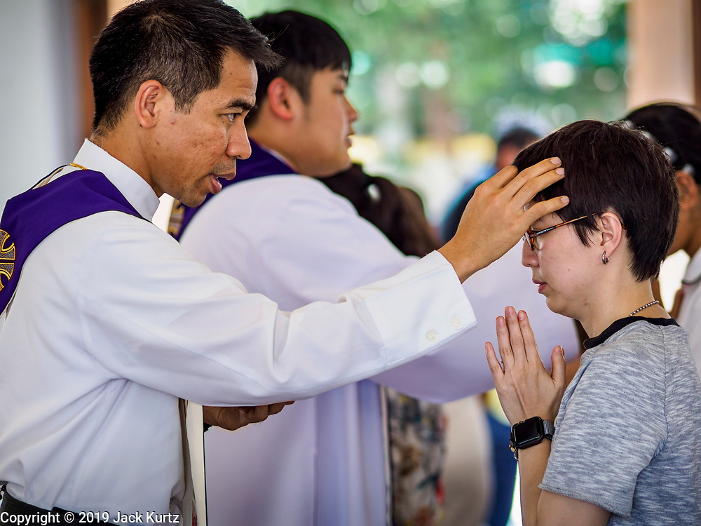 06 MARCH 2019 - BANGKOK, THAILAND: A priest annoints churchgoers with ashes at Holy Redeemer Catholic Church in Bangkok on Ash Wednesday. There are about 300,000 Catholics in Thailand in about 430 Catholic parishes and about 660 Catholic priests in Thailand. Thais are tolerant of other religions and although Thailand is officially Buddhist, Catholics are allowed to freely practice and people who convert to Catholicism are not discriminated against.    PHOTO BY JACK KURTZ