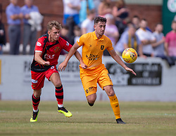 Annan Athletic's Ryan Salmon and Livingston Shaun Byrne. Livingston 1 v 0 Annan Athletic, Scottish League Cup Group F, played 21/7/2018 at Prestonfield, Linlithgow.