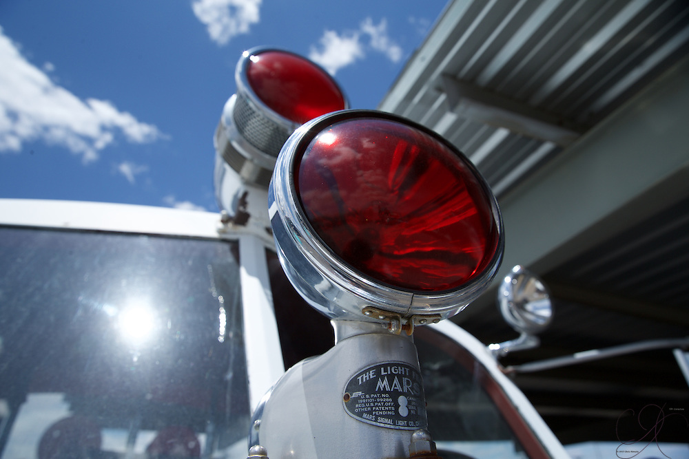 The light from Mars adorns an early 1950s American LaFrance-Foamite fire pumper truck