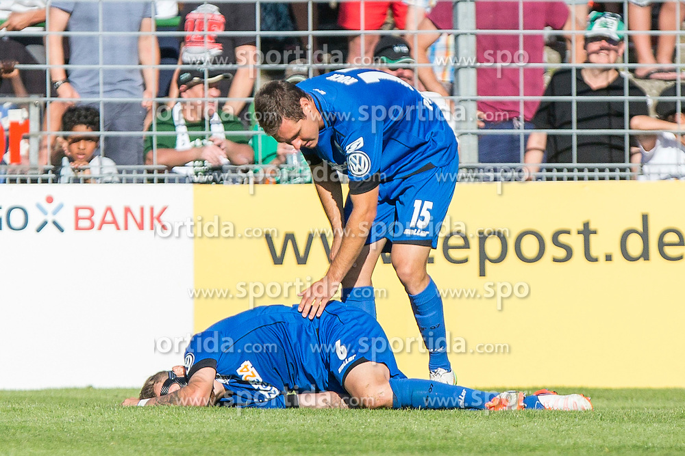 09.08.2015, Stadion Lohmühle, Luebeck, GER, DFB Pokal, VfB Luebeck vs SC Paderborn 07, 1. Runde, im Bild Marvin Bakalorz (Nr. 6, SC Paderborn) liegt verletzt an Boden, Florian Ruck (Nr. 15, SC Paderborn) steht neben ihm // during German DFB Pokal first round match between VfB Luebeck vs SC Paderborn 07 at the Stadion Lohmühle in Luebeck, Germany on 2015/08/09. EXPA Pictures © 2015, PhotoCredit: EXPA/ Eibner-Pressefoto/ KOENIG<br /> <br /> *****ATTENTION - OUT of GER*****