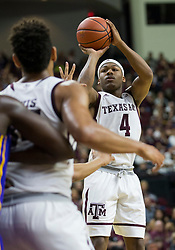 Texas A&M guard JJ Caldwell (4) attempts a three point basket against LSU during the first half of an NCAA college basketball game Saturday, Jan. 6, 2018, in College Station, Texas. (AP Photo/Sam Craft)