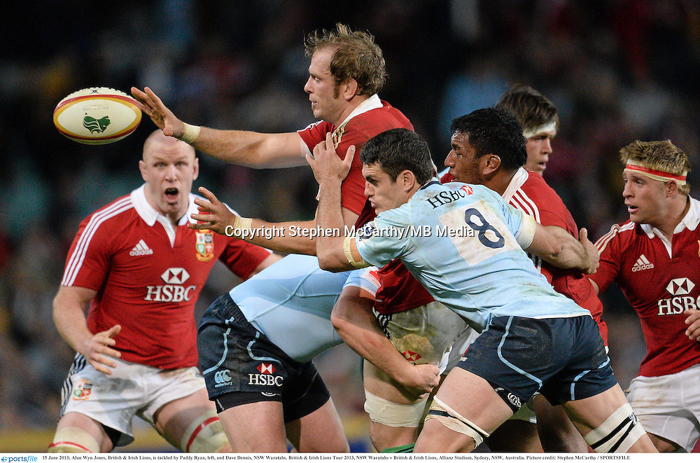 15 June 2013; Alun Wyn Jones, British & Irish Lions, is tackled by Paddy Ryan, left, and Dave Dennis, NSW Waratahs. British & Irish Lions Tour 2013, NSW Waratahs v British & Irish Lions, Allianz Stadium, Sydney, NSW, Australia. Picture credit: Stephen McCarthy / SPORTSFILE