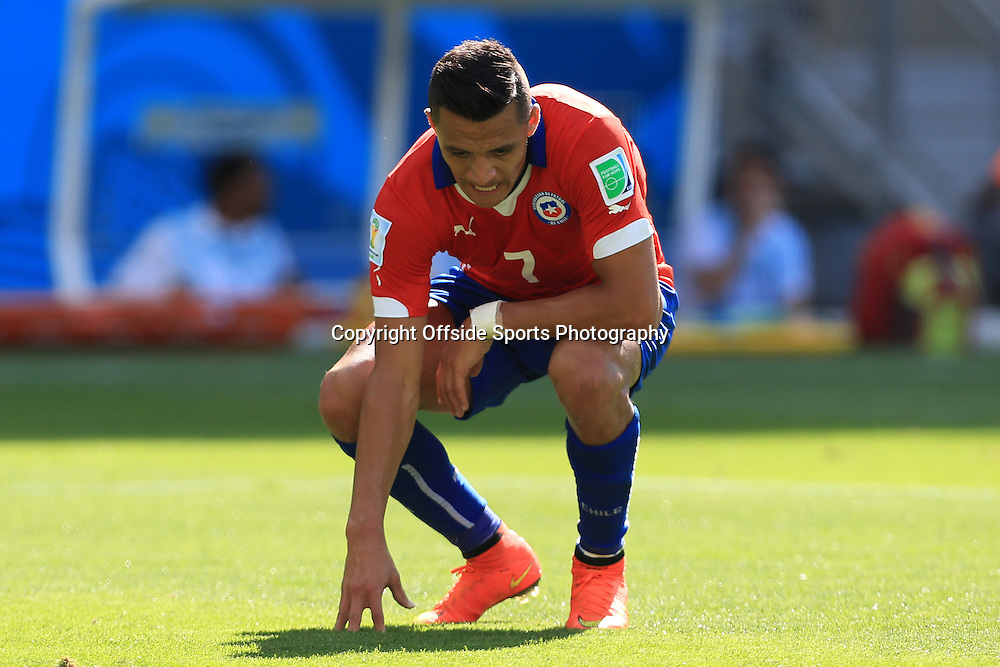28th June 2014 - FIFA World Cup - Round of 16 - Brazil v Chile - Alexis Sanchez of Chile looks dejected - Photo: Simon Stacpoole / Offside.
