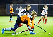 HUIZEN - hoofdklasse competitie dames, Huizen-Groningen . Willemijn Bos (Gron.) met Mascha Heemskerk (Huizen)   COPYRIGHT KOEN SUYK