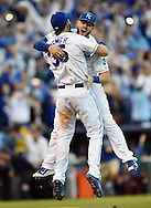 Oct 15, 2014; Kansas City, MO, USA; Kansas City Royals infielders Eric Hosmer (35) and Mike Moustakas (8) celebrate after defeating the Baltimore Orioles in game four of the 2014 ALCS playoff baseball game at Kauffman Stadium. The Royals swept the Orioles to advance to the World Series.