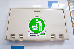 Baby nappy changing unit in changing room at sports leisure centre,